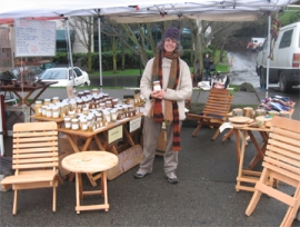 Honey, Handcrafted Furniture, and beekeeper Bean in Brookfield Farm's market booth at Seattle's Fremont Market